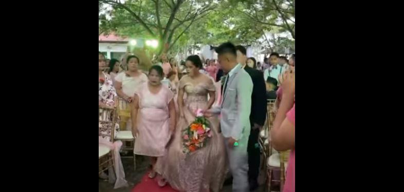 تعثرت فخرج رجل من تحت فستانها يوم زفافها (فيديو)